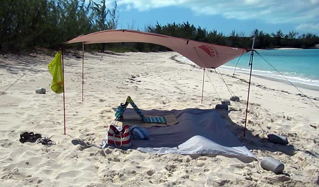 9 foot Kelty Noahu0027s tarp used as a beach shelter sun shade on Jolly Hall beach & The Kelty Noahu0027s Tarp as a Beach Shelter Sun Shade - Travel-Snobs.com